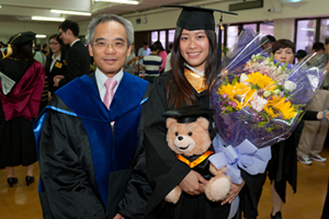 A BBA graduate took a photo with Professor Raymond So, Dean of School of Business after the Graduation Ceremony.