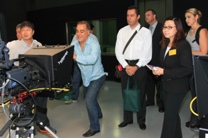 Prof Scarlet Tso (second right) showed the delegation the TV studio of the School of Communication