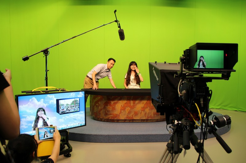 Students from Sichuan University was learning how to be a broadcast journalist