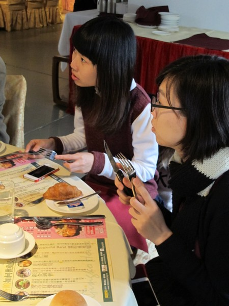 Professors and students paying high attention to learning table manners