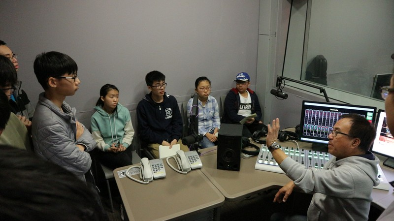 Mr Eric Ng explained how to use the recording equipment in a studio -1