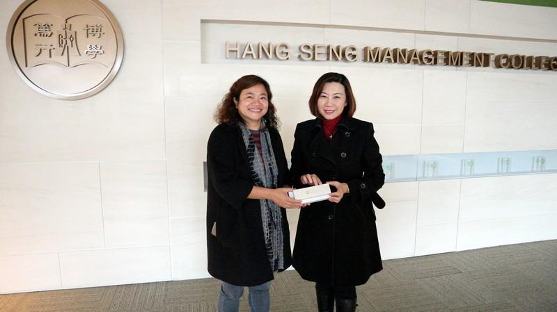 Dean Scarlet Tso presented a souvenir
