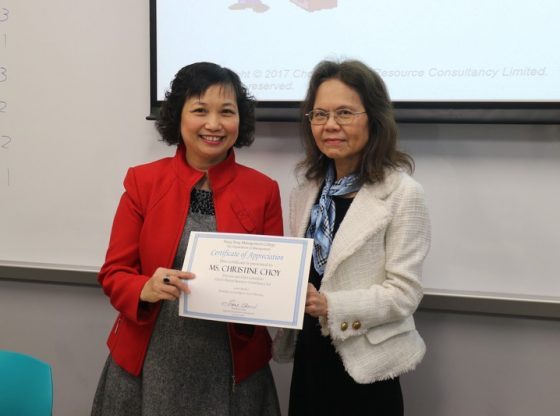 Prof Chow presented a certificate of appreciation to Ms Choy