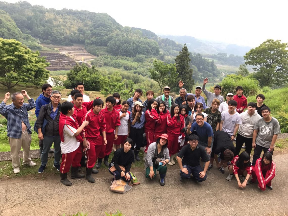 Taking part in a social service activity with local high school and university students.