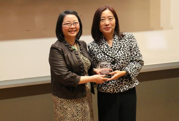 Ms Joanna Kwok presented a souvenir to Ms Evangeline Ho, General Manager of Nova Training & Education Institute (left)