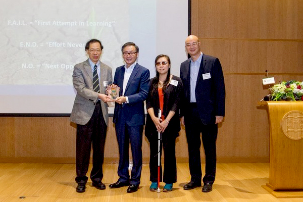 Vice-President Y V Hui (Academic and Research) (left) presented a souvenir to Mr Sunny Wong (2nd from left)