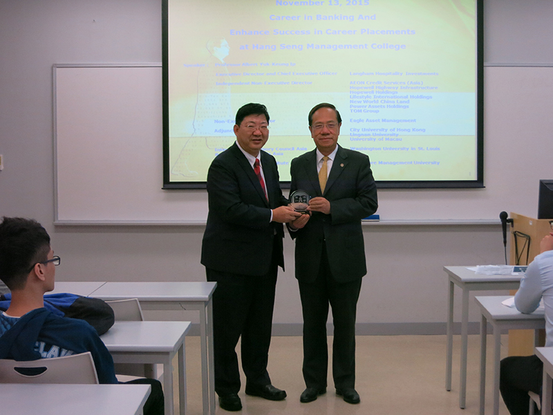 President Simon S M Ho presented a souvenir to Professor Yip
