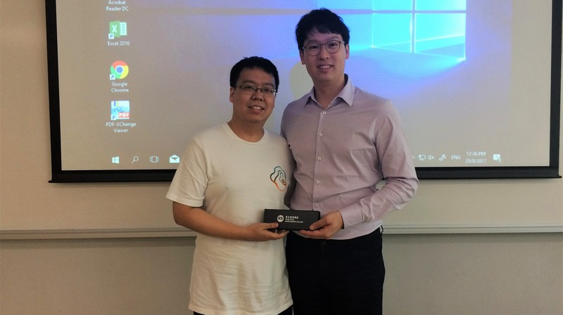 Dr Wong Wai Kit, Head of Department of Computing, presented a souvenir to Mr Ronald Tse (right).