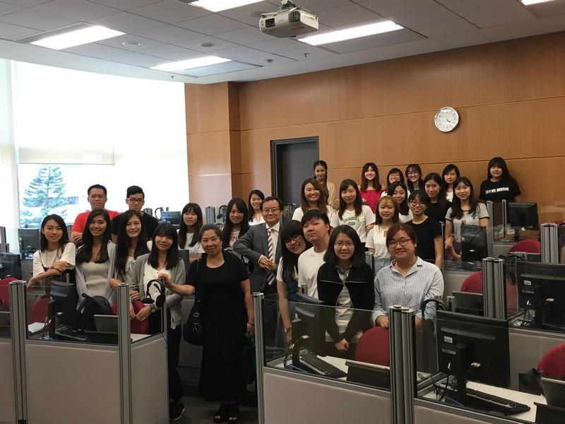 The visiting group with Dr Cheung King Man, the module teacher of Consecutive Interpreting, and BTB students
