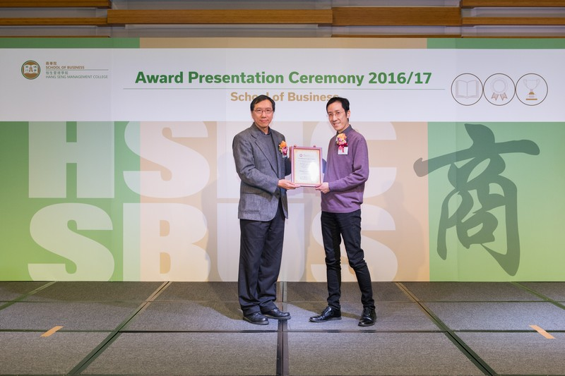 Dr Haksin Chan, Head of Department of Marketing (left), presented the award to Dr Felix Tang.