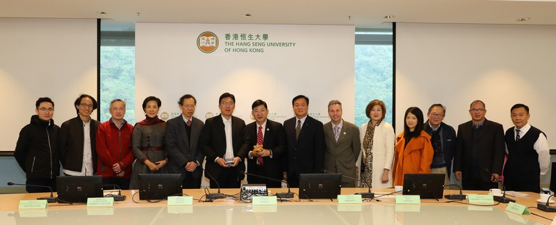 A group photo of Dr George So (7th from right) and President Hao Zhifeng (6th from left) with President Simon Ho (7th from left) and HSUHK representatives