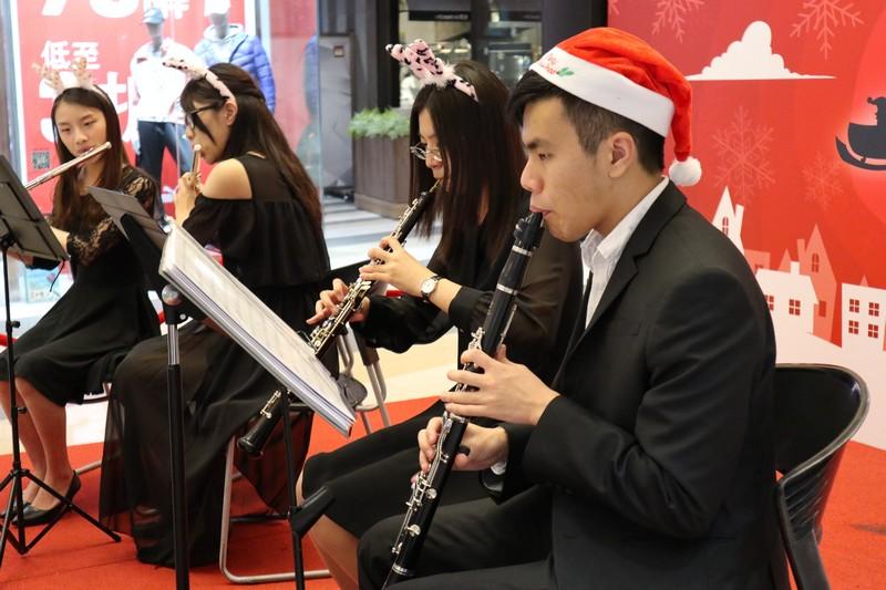 The orchestra brought seasonal joy to visitors at MegaBox.