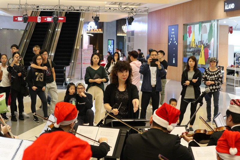 Families visiting the shopping mall came to enjoy the music performance.