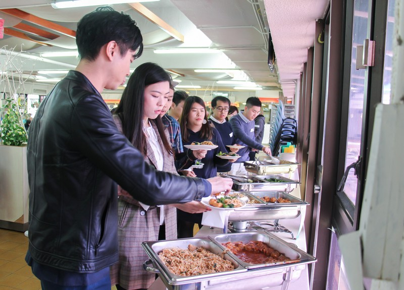 Graduates enjoyed a lunch buffet together.