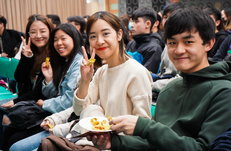Students were enjoying snacks at the event.
