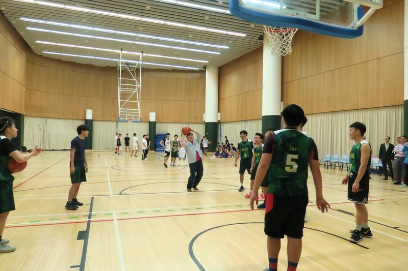President Simon Ho was playing basketball with residents.