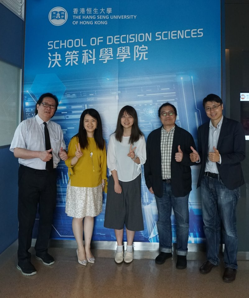 The awardee Charlie Lam (middle) pictured with representatives of the School of Decision Sciences