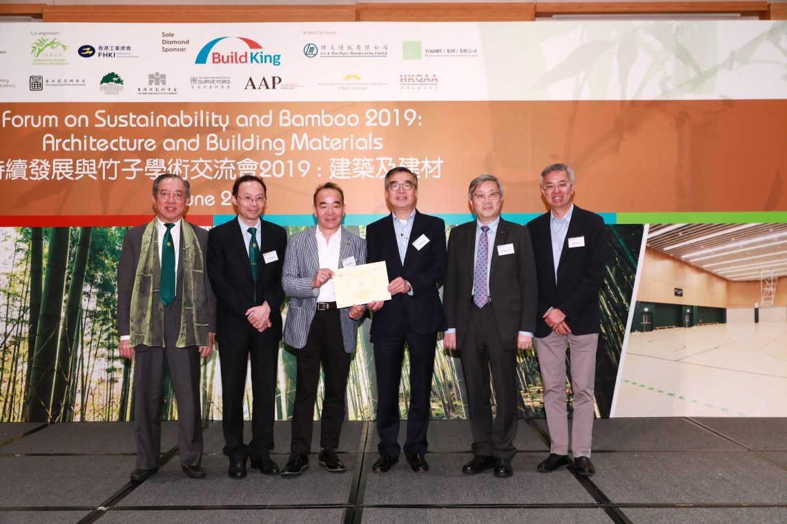 Mr Martin Tam and Dr Tom Fong jointly presenting souvenir with 3 Vice-Chairmen of FHKI-BIC to a representative of Bamboo International (Group) Co., Ltd.