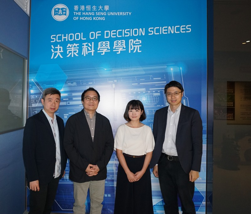 Jessie Poon (2nd from right) pictured with representatives of the School of Decision Sciences