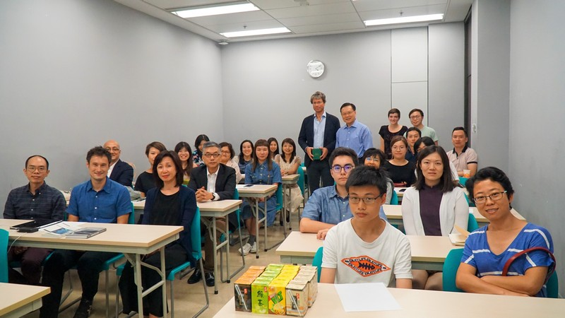 Group photo of Professor Frode Helland, all participating academic staff of SHSS and students from HSUHK