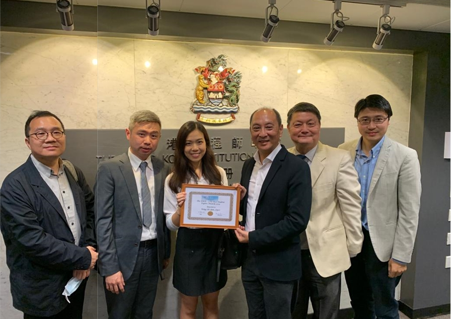 Group photo of Joyce Wong (3rd from left) with the representative from HKIE (3rd from right) and representatives of the School of Decision Sciences