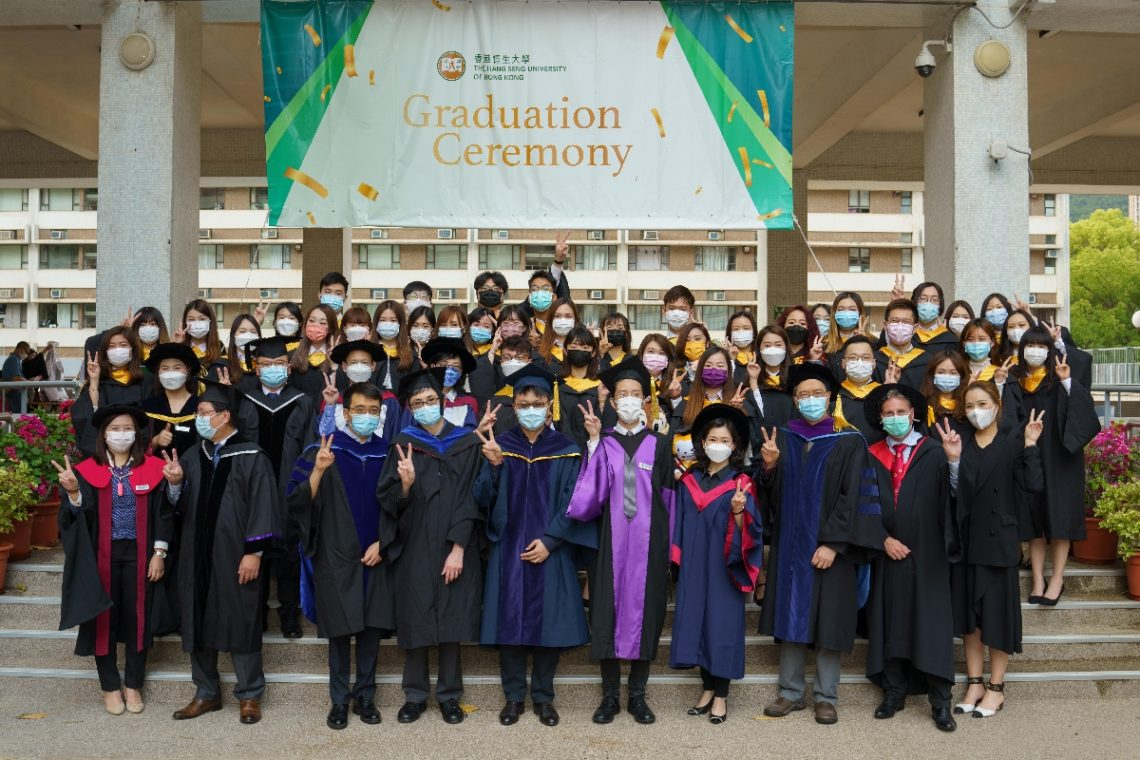 Graduates of the School of Business share their happiness with the faculty members.