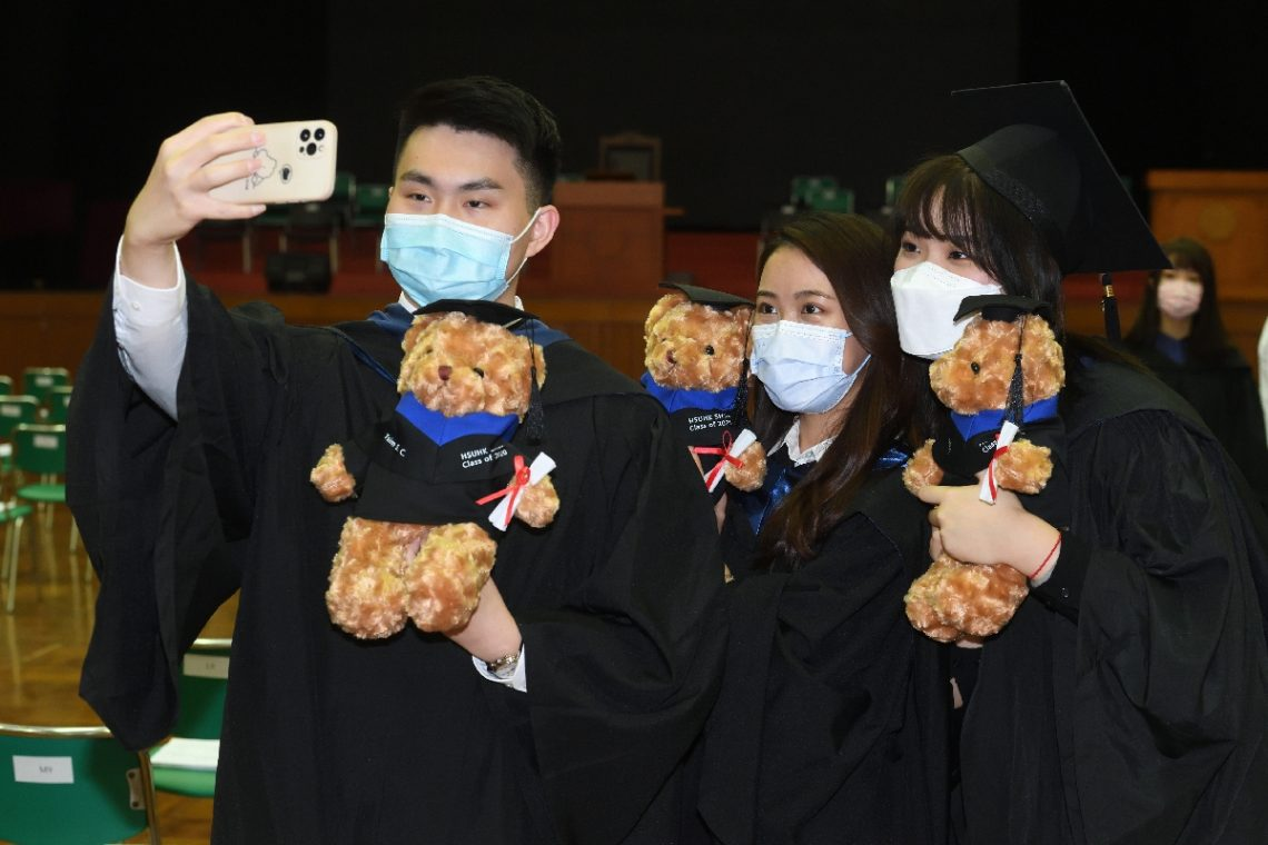 Graduates took photos with their personalised graduation bear, a gift from the School.