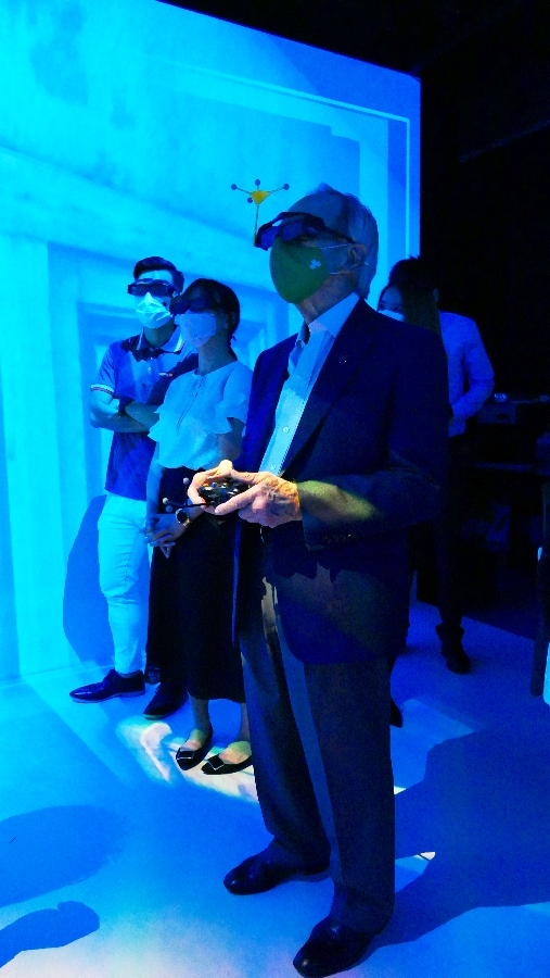 Mr James Thompson is tremendously intrigued by the state-of-the-art remote control at the Virtual Reality Centre.